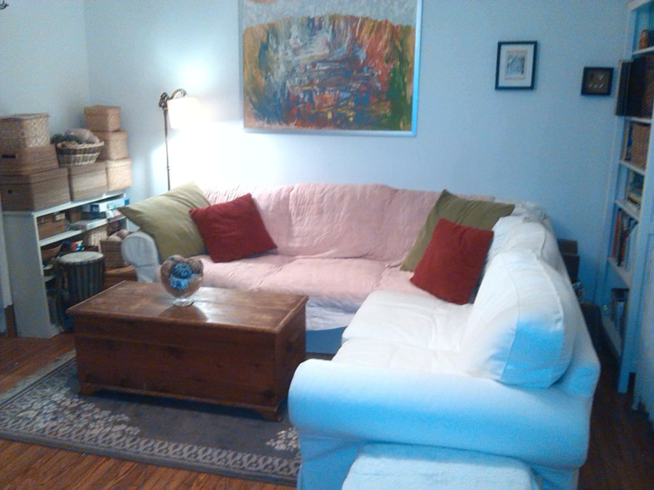 the cozy living room.  the couch is so comfy!  a perfect place to curl up with a book and a tea.  (or your computer...)