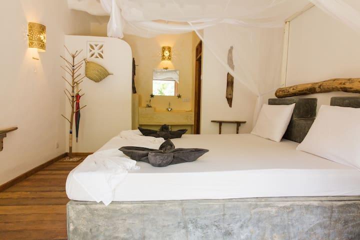 Chambre double JUA et salle de bain