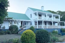The Country house in Belvidere is situated on upper Duthie with sweeping views over the Knysna lagoon and indigenous garden.