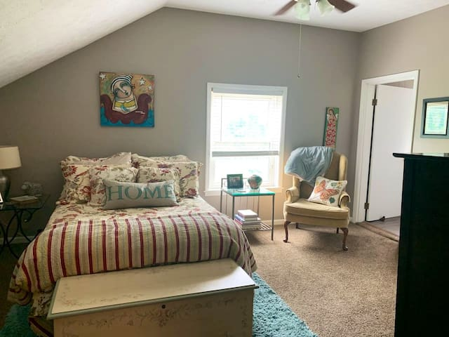 Full Bedroom adjacent to claw foot tub/shower bathroom. Also has a large clothes closet (where a vacuum is also stored for use) & a full dresser for guest's clothes.