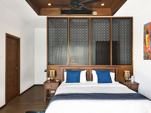 Our master bedroom is a true luxury of it's own. With a pool view and a large master bathroom, this is your own private hide away when you need it. It's kinda perfect for a honeymoon too.