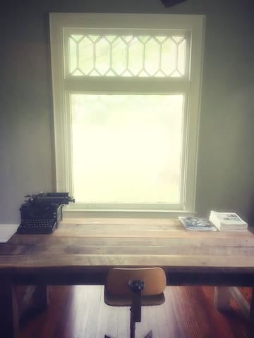Private office and a perfect place to write, work, or read. We have a double bed in this space as well.