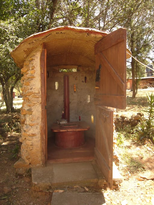 Eco-friendly long drop toilet right next to the tent.