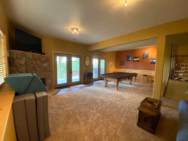 Walk out basement game room with pool table.