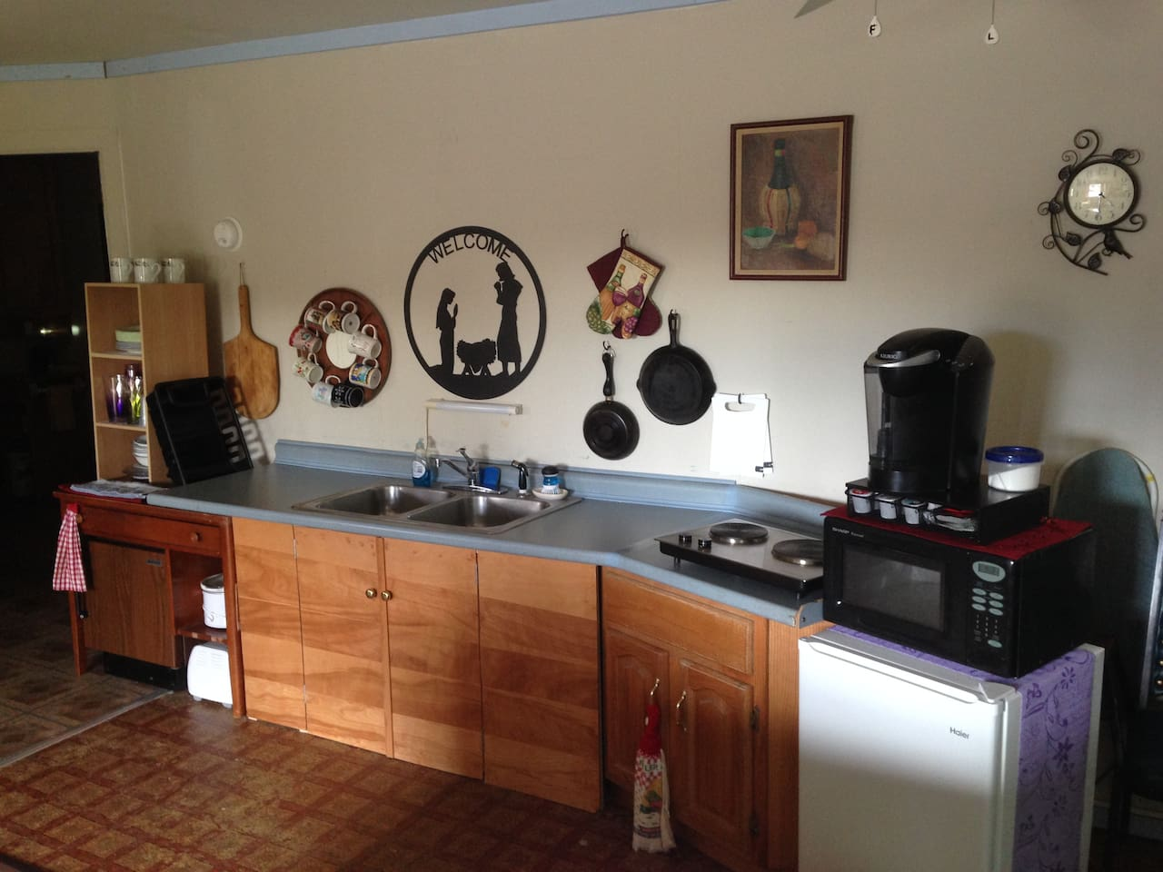 Kitchenette with counter cooktop, microwave, Keurig coffee maker,  toaster over, utensils and more.
