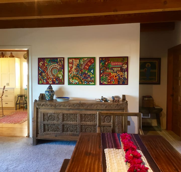 Dining area decorated with locally made furniture and folk art from around the world.