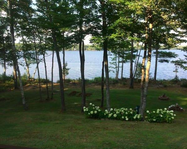 Log cabin   Lake Sunrise  kayaks   Swim   Family