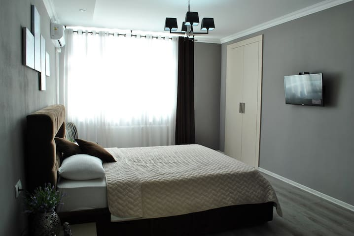 Bedroom with Air Conditioner& Tv