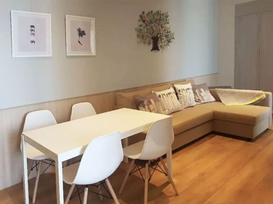 Spacious living & dining area. L-shape sofa can be turned into a bed for 2 person.