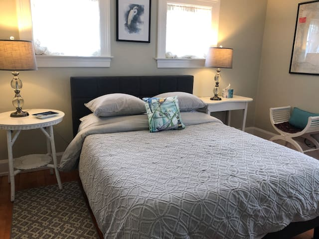Queen size memory foam mattress and eco-friendly linens. Low country touches with marsh and coastal art prints from the Atlantic barrier islands.