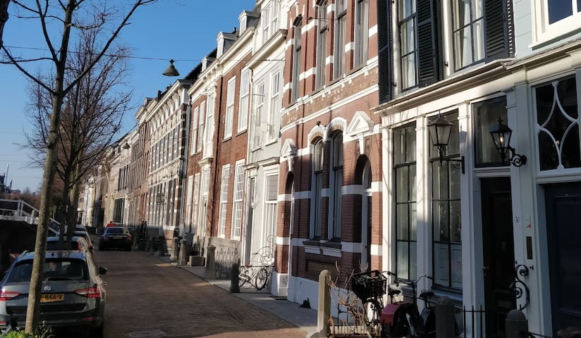 The house is the one on the right, with the dark shutters
