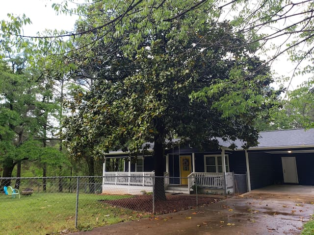 Covered carport and fenced front yard is excellent for four-legged friends