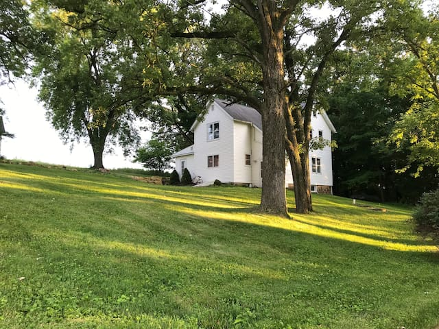Hillside farm house with beautiful sunrise