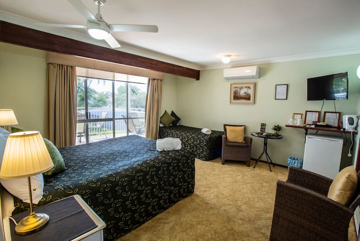 Deluxe Queen room with extra bed first floor. This room opens directly onto the deck.