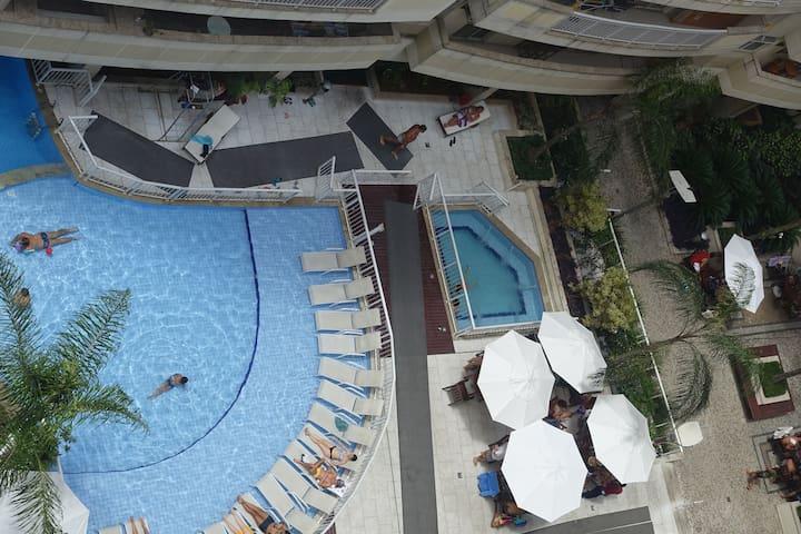 Quarto em condominio com piscina