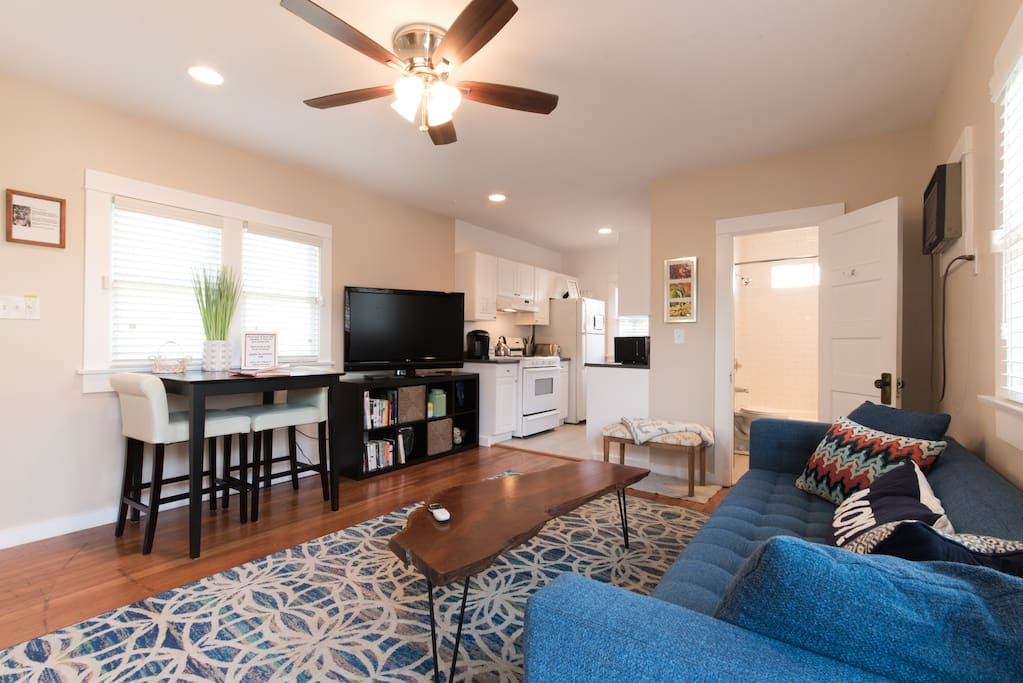 """Living room with 47"""" TV connected to Direct TV."""