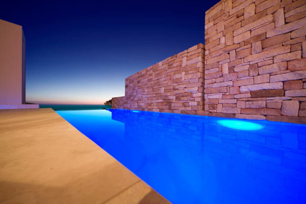 Sparkling blue pool with sea views