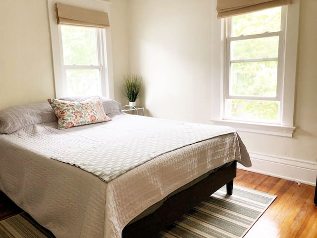2nd bedroom with a queen memory foam mattress and is facing the road.