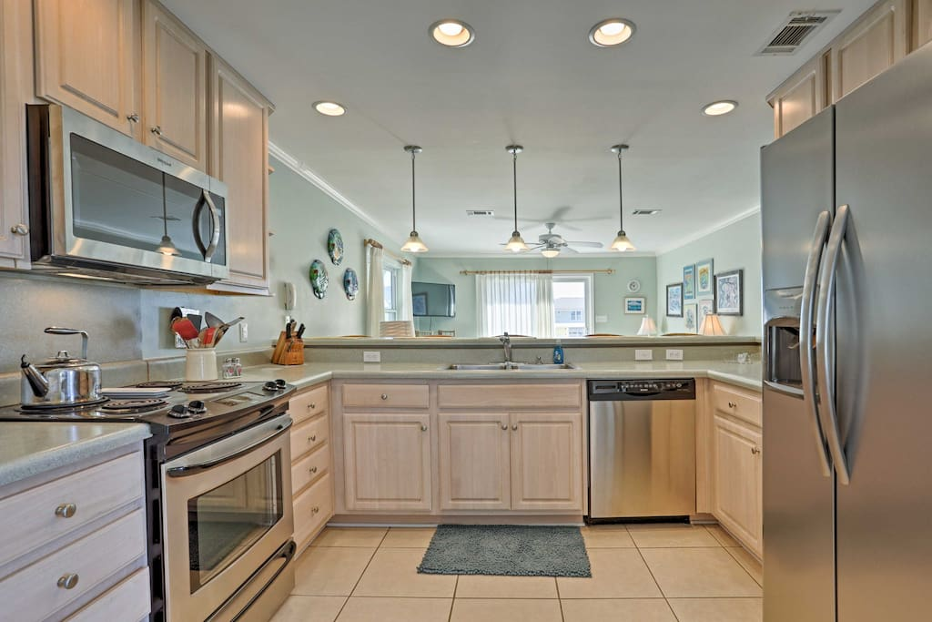 Stainless steel appliances and ample counter space make home-cooking a breeze.