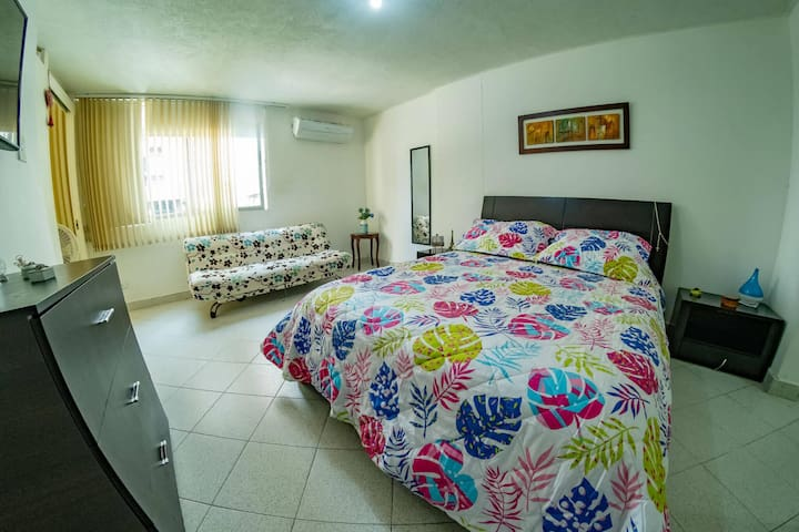 Spacious room for 3 people with private bathroom near the beach