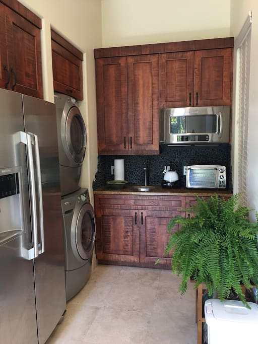 Kitchen with full fridge, washer/dryer, microwave, small convection oven, coffee maker & hot plate for cooking