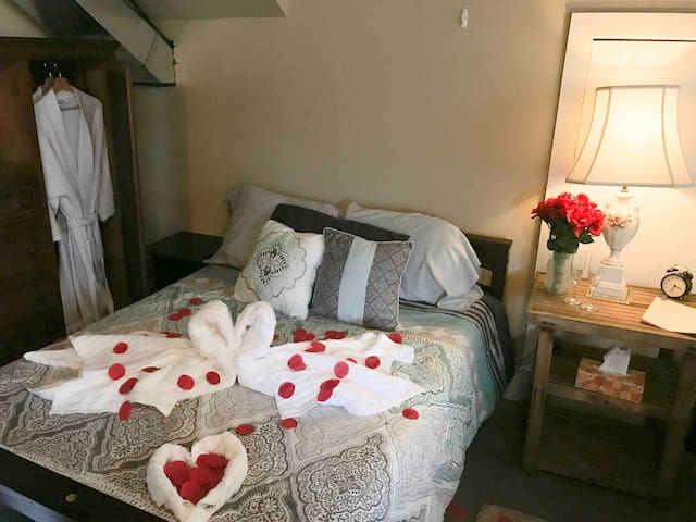 Towels formed into swans, chocolates, and rose petals set on the bed for a couple who chose to stay with us on their wedding night. :)