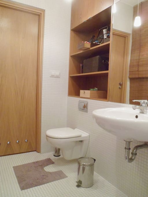 Spacious bathroom finished in wood