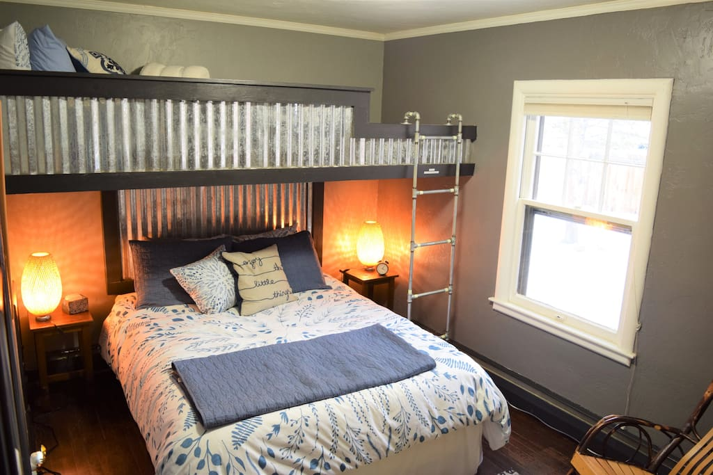 This guest room includes a queen size bed, and cozy twin loft bed above. This room has a closet, dresser, TV, and rocking chair. There is no satellite or cable TV, so bring your device to connect via HDMI, or stream through our Roku device.