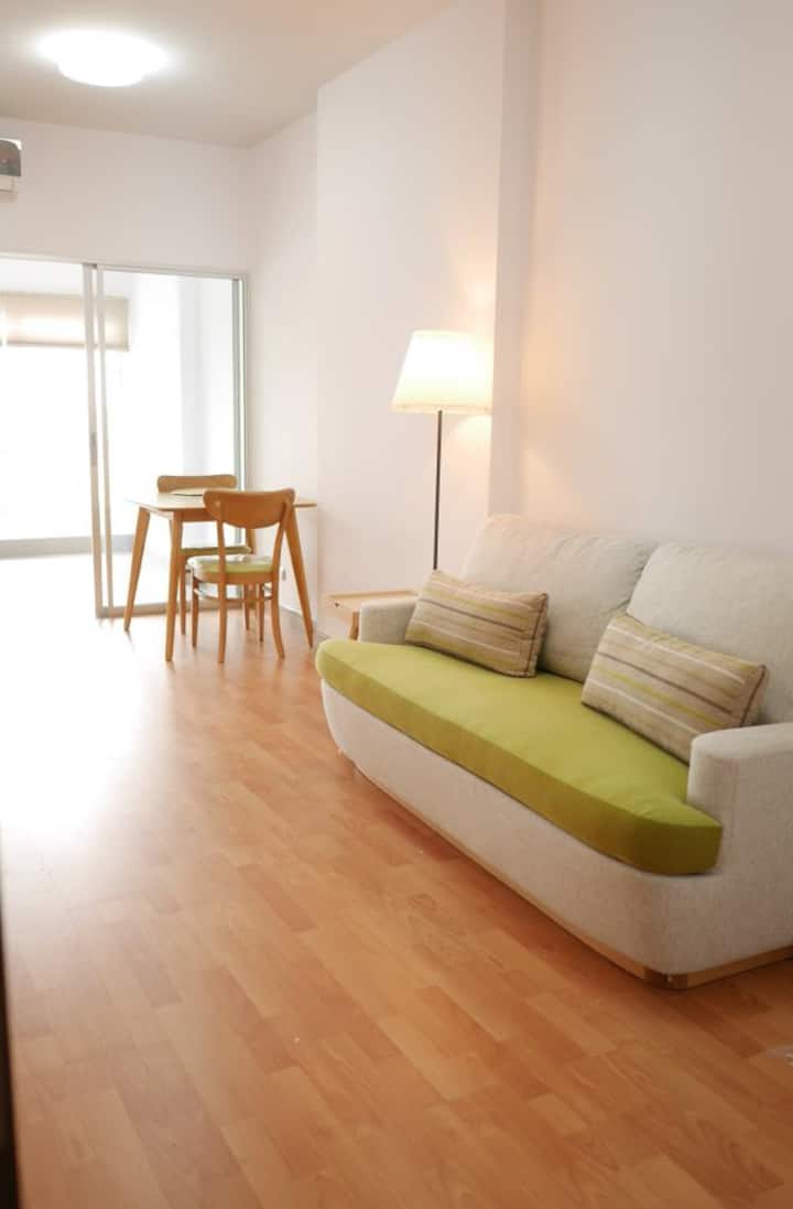 Cozy, Furnished 1 Bedroom in High Rise City Condo.