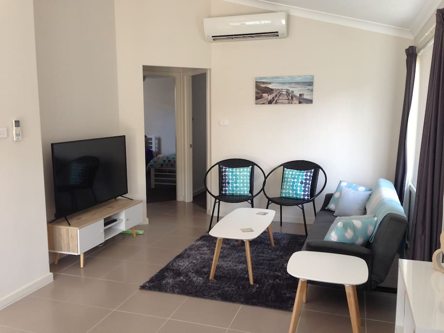 Lounge with HD TV and reverse cycle airconditioning