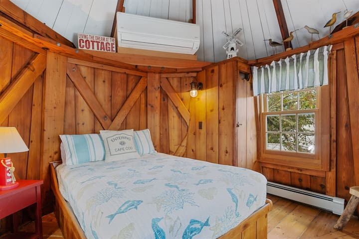 Full size bed in second floor loft bedroom.