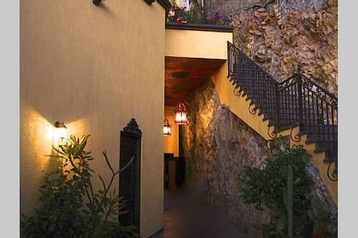 Entry patio with fountain and natural rock walls welcomes  you to Casa Amistad