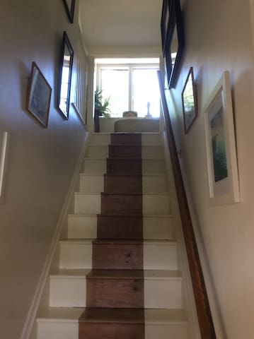 Private entrance and staircase to bedroom and own bathroom.
