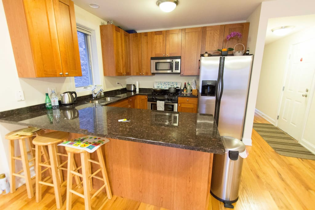 Kitchen with cherry cabinets, granite counter top, and stainless steel appliances