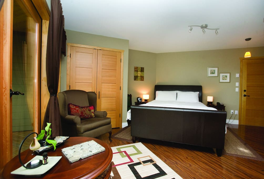 Each B&B suite has a Swiss TempurPedic Queen bed, an air conditioner, wooden floors, a large private handicapped friendly bathroom with shower and a heated tile floor, bathrobes, a hair drier, a private phone, a wall mounted flat screen TV with cable on a swivel that can be viewed from the bed or the sitting area, a microwave, a small fridge, a coffee maker (coffee, cream/milk and sugar supplied), kettle and tea pot, (a selection of teas supplied), dishes and silverware, and a counter top with a sink, and free high speed wireless internet service.