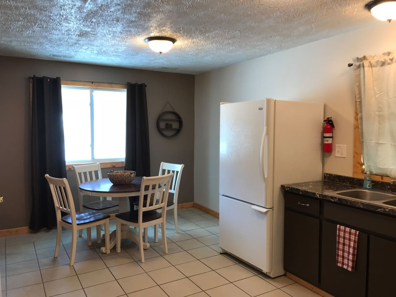 Full Kitchen with Dining area that seats 4.