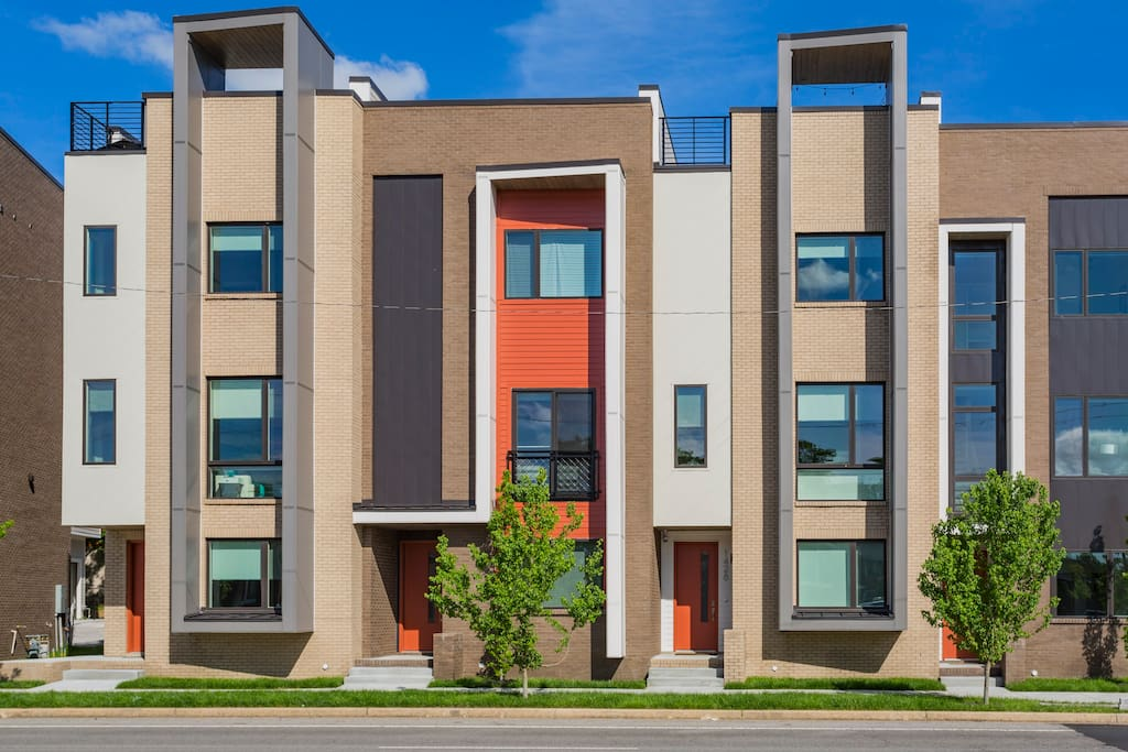 """Modern exterior, beautiful sidewalks, and street access for ease of """"out-the door"""