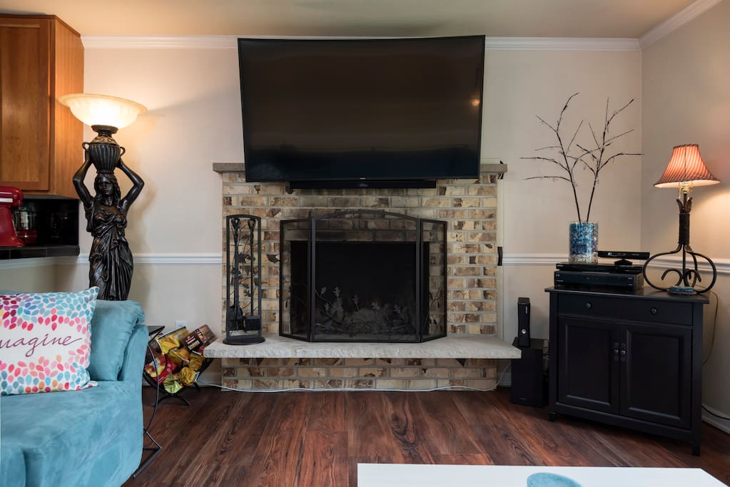Cozy Fire Place keeps things soft and warm, hard wood floors throughout the home.
