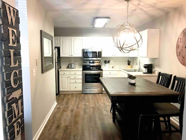 Full eat in kitchen with large dining table with wine storage