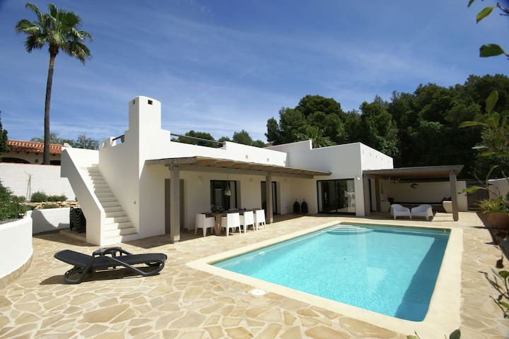 Modern villa in the typical Ibizan-style furnishings and a private pool