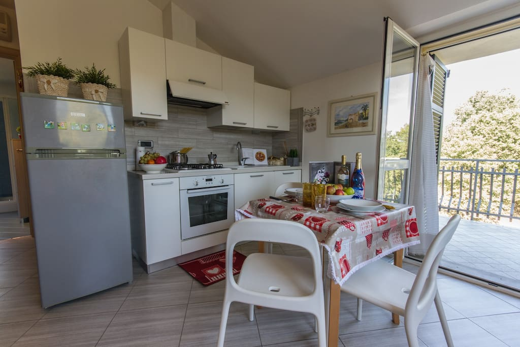 Living area with fully fitted kitchen, dining area and access to terrace.