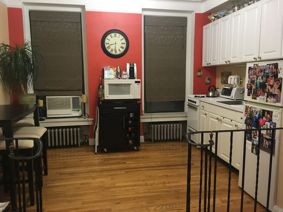kitchen with full refrigerator, full size oven/stove, microwave, toaster oven, dining room table & 4 stools