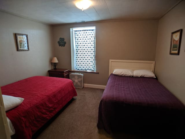 Bedroom 4 with two double beds