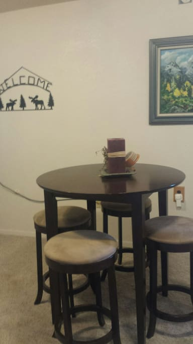 Table & chairs in the den for your business or pleasure use.