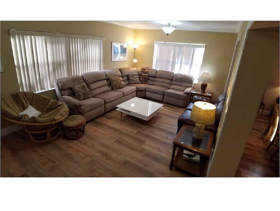 Living Room with sectional couch that has two Lay-Z-Boy recliners and a sleeper sofa. Also: a comfy leather couch.  55-inch TV w/local channels, Netflix & tons of other content. BluRay player with many movies on hand. A very accommodating place.