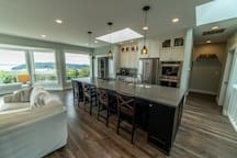 Modern kitchen with double oven, large spacious island with bar stools. Great for entertaining.