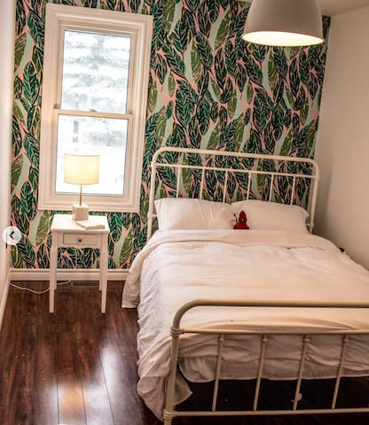 The 'Cardinal' guest room features a hotel comfort queen-sized bed with 600 thread count sheets, down duvet, armoire for your clothes and end table with reading lamp.>>>