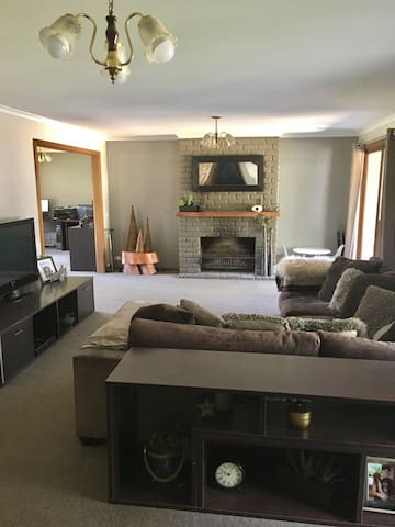 "Large lounge room with a massive comfy couch for you to sit back and watch whatever you like on either Foxtel or Netflix on the whopping 65"" smart TV. There is  also R/C air con & open fire."