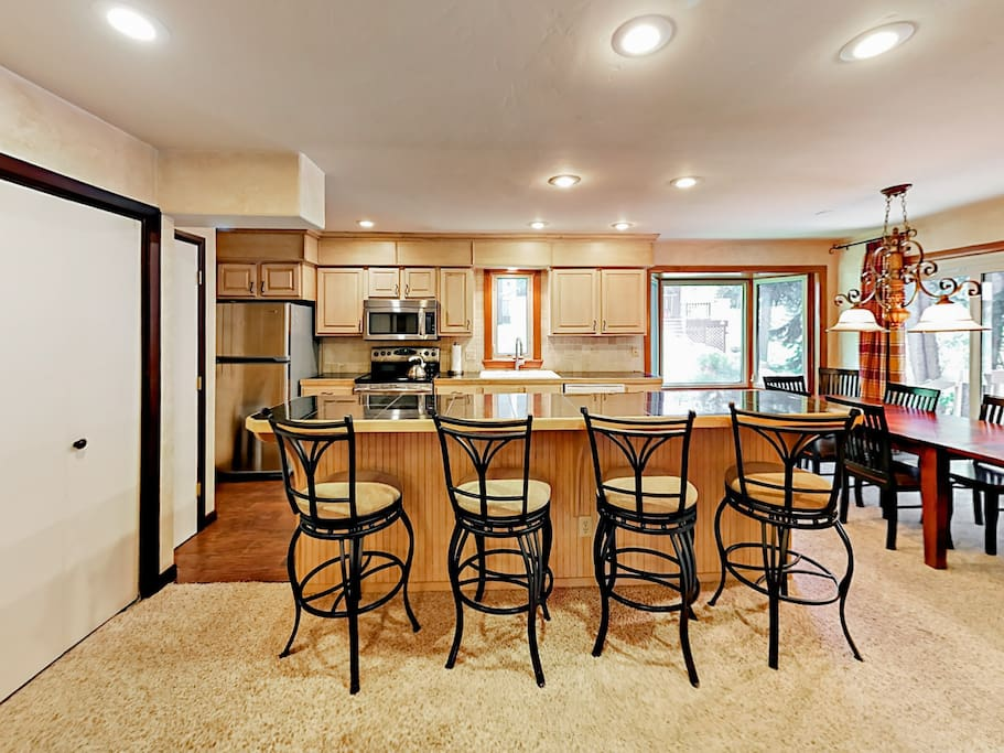 Granite tile countertops and stainless steel appliances add an elegant element to the open kitchen.