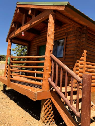 Outside view of the cabin front porch area.